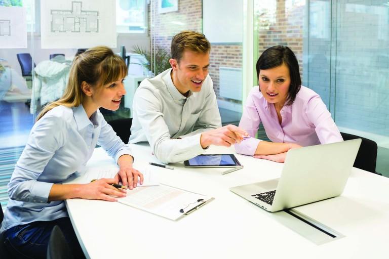 Businesswoman businessman reunion computer desk colleagues